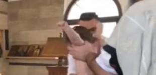 Σοκαριστικές εικόνες από βάφτιση, προκλήθηκαν μώλωπες στο μωρό (βίντεο)